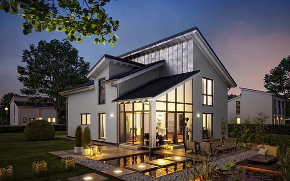 Massivhaus Familienhaus Akzent Gartenseite am Abend von Kern-Haus