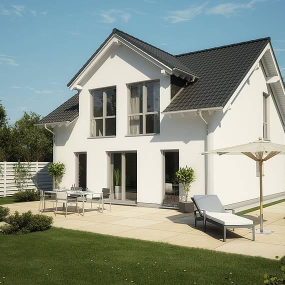 Massivhaus Kern-Haus Familienhaus Komfort Satteldachgaube Gartenseite