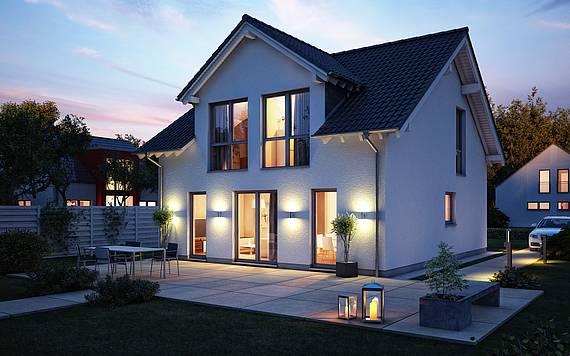 Massivhaus Kern-Haus Familienhaus Komfort mit Satteldachgaube am Abend