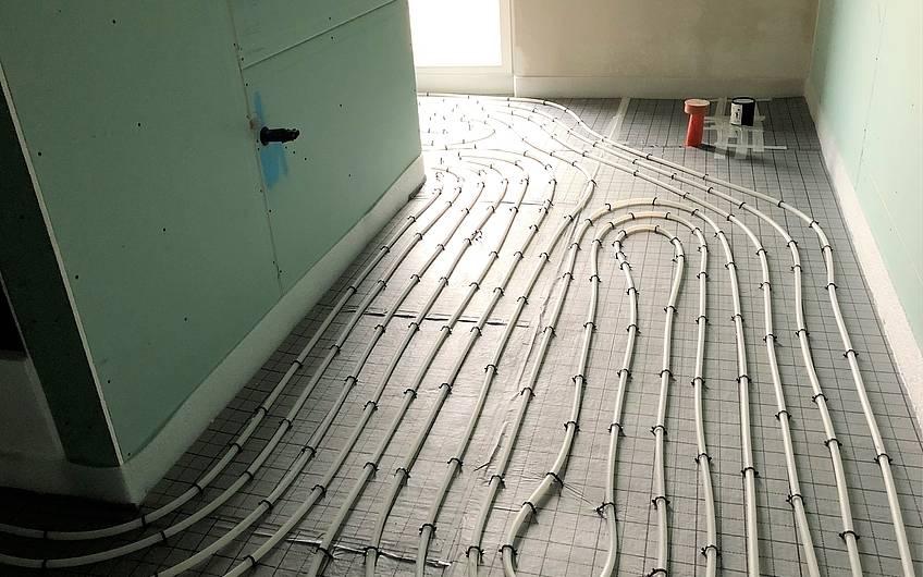 Spiralförmige Verlegung von Heizschleifen in einem Kern-Haus