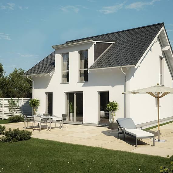 Massivhaus Kern-Haus Familienhaus Komfort Flachdachgaube Gartenseite