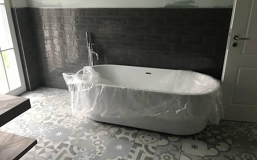 Badezimmer im individuell geplanten Einfamilienhaus Aura von Kern-Haus in Weinheim-Rippenweier