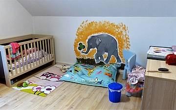 Kinderzimmer im individuell geplanten Einfamilienhaus Signum von Kern-Haus in Römerberg