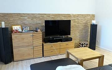 Wohnzimmer im individuell geplanten Einfamilienhaus Signum von Kern-Haus in Römerberg