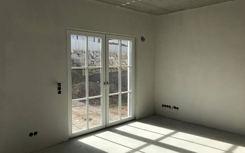 Raum im Erdgeschoss des individuell geplanten Einfamilienhauses Aura von Kern-Haus in Weinheim-Rippenweier