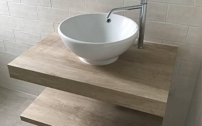 Waschtisch im individuell geplanten Einfamilienhaus Aura von Kern-Haus in Weinheim-Rippenweier
