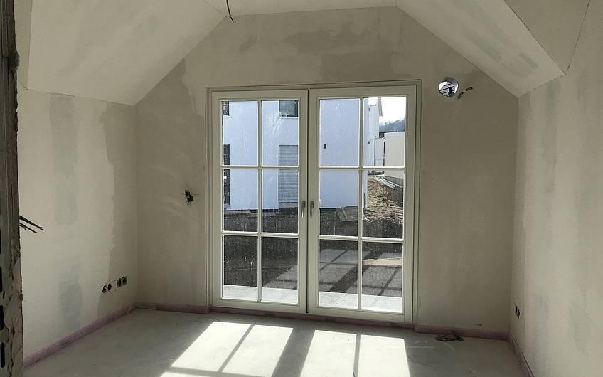 Raum im Dachgeschoss des individuell geplanten Einfamilienhauses Aura von Kern-Haus in Weinheim-Rippenweier