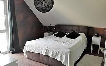 Schlafzimmer im individuell geplanten Einfamilienhaus Signum von Kern-Haus in Einselthum