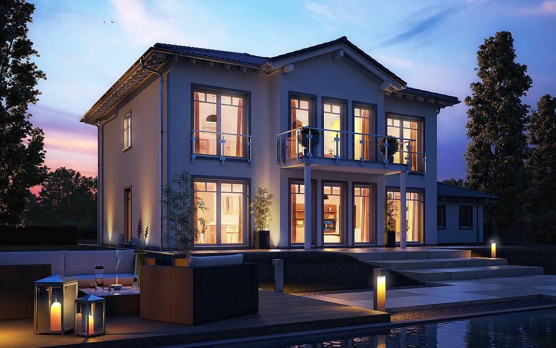 Massivhaus Kern-Haus Stadtvilla Karat Gartenseite am Abend